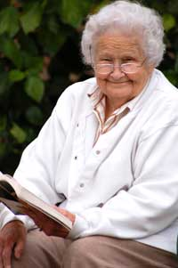 Elderly lady reading a book