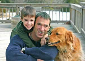 father and son with dog