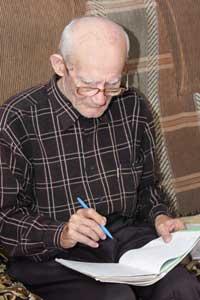 senior man looking at notes